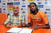 Alanyaspor's new transfer Abdoulaye Ba and Alanyaspor club president Hasan Cavusoglu attend the contract signing ceremony at Cengiz Aydogan Sports...