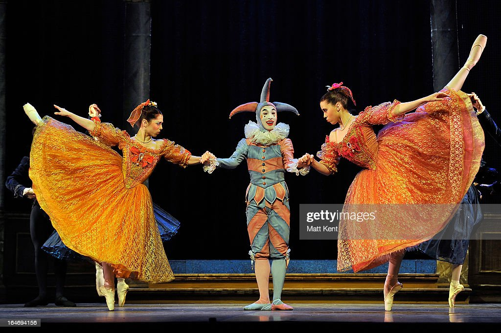 Alanze Lopez Extebarria (L) and Gretel Palfrey (R) as the step sisters and Matthew Koon as the Jester perform during the dress rehearsal for the English National Ballet's 'My First Cinderella' at The Peacock Theatre on March 26, 2013 in London, England.