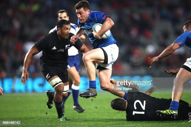 Alapati Leiua of Samoa skips the tackle of Sonny Bill Williams of the All Blacks during the International Test match between the New Zealand All...