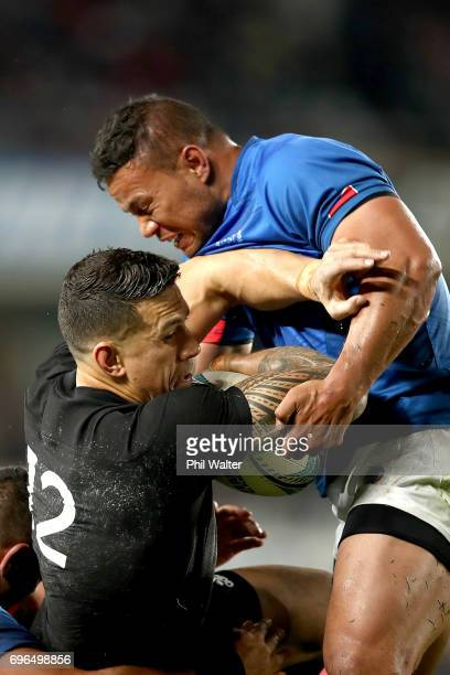 Alapati Leiua of Samoa tackles Sonny Bill Williams of the All Blacks during the International Test match between the New Zealand All Blacks and Samoa...