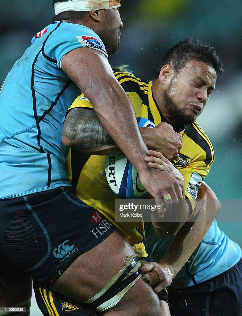 Alapati Leiua of the Hurricanes is tackled during the round 15 Super Rugby match between the Waratahs and the Hurricanes at Allianz Stadium on June 2, 2012 in Sydney, Australia.