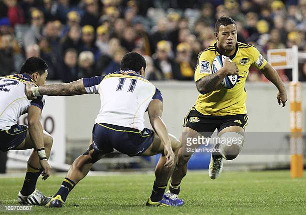 Alapati Leiua of the Hurricanes runs the ball during the round 16 Super Rugby match between the Brumbies and the Hurricanes at Canberra Stadium on...