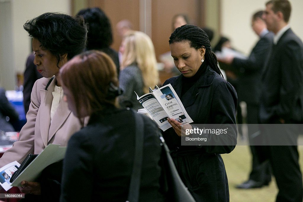 Alara Tylor looks at a company brochure at a National Career Fairs job fair in Arlington, Virginia, U.S., on Wednesday, Jan. 30, 2013. The U.S. Labor Department is scheduled to release initial jobless claims data on Jan. 31. Photographer: Andrew Harrer/Bloomberg via Getty Images