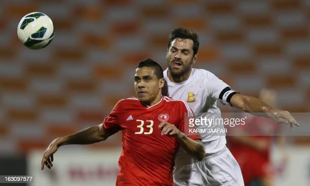 AlArabi's Brazilian forward Wanderley Santos challenges Australia's defender Sasa Ognenovski of Umm Salal during their Qatar Stars League football...