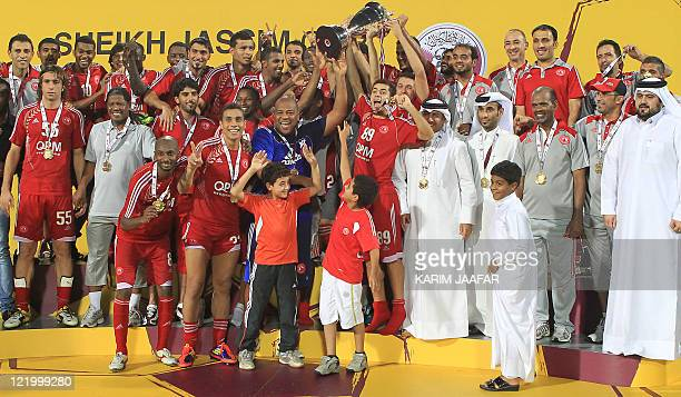 AlArabi's players celebrate with the trophy after beating Umm Salal to win the Sheikh Jassem Cup in the Qatari capital Doha late on August 24 2011...