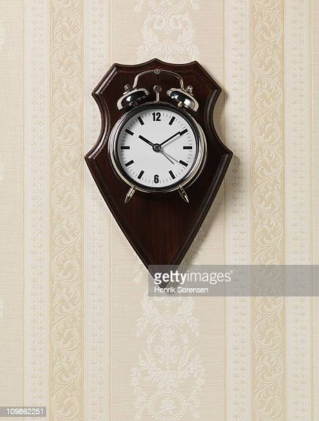 Alarm clock hanging as a trophy on a wall