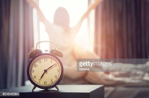 alarm clock having a good day in morning. : Stock Photo