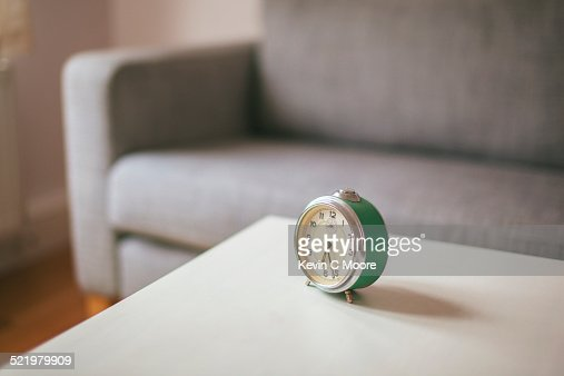 Alarm clock on coffee table in living room
