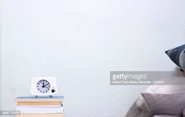 Alarm Clock On Stack Of Books At Home