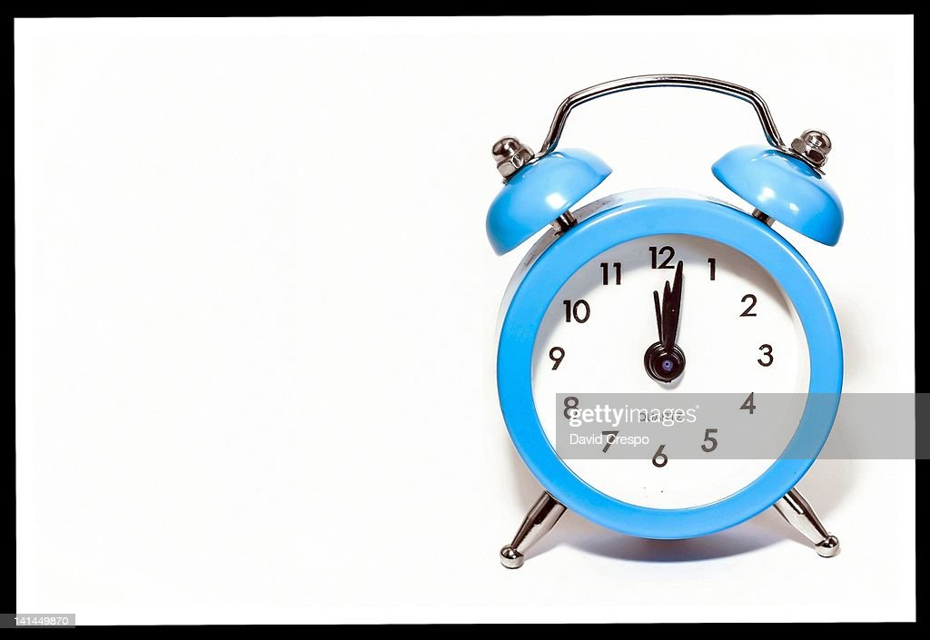 Alarm clock on white background. : Stock Photo
