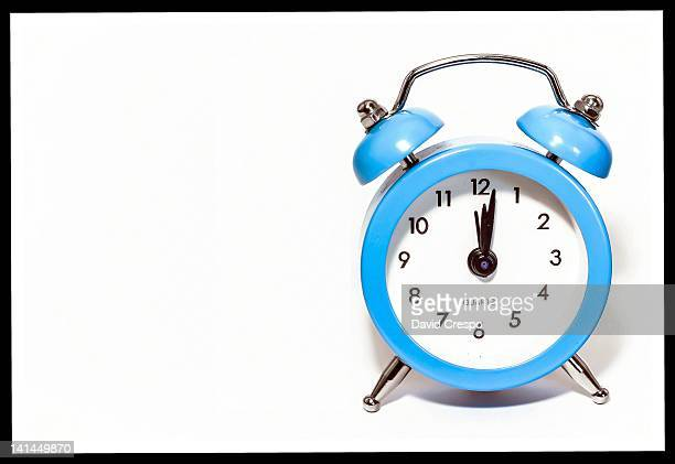 Alarm clock on white background.