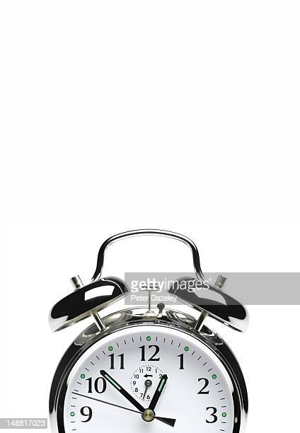 Alarm clock on white with copy space
