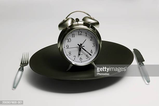 Alarm clock standing on black plate