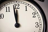 Black alarm clock watch with white background