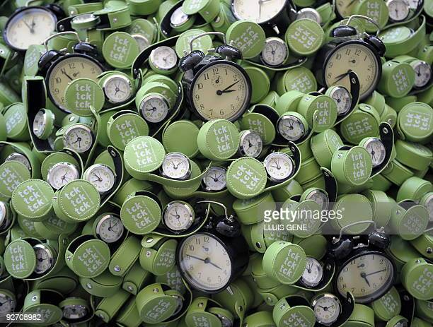 Alarm clocks are piled up during the Climate Change Conference in Barcelona on November 4 symbolizing the fact that time is running out for world...