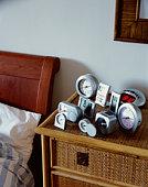 Alarm clocks on bedside table