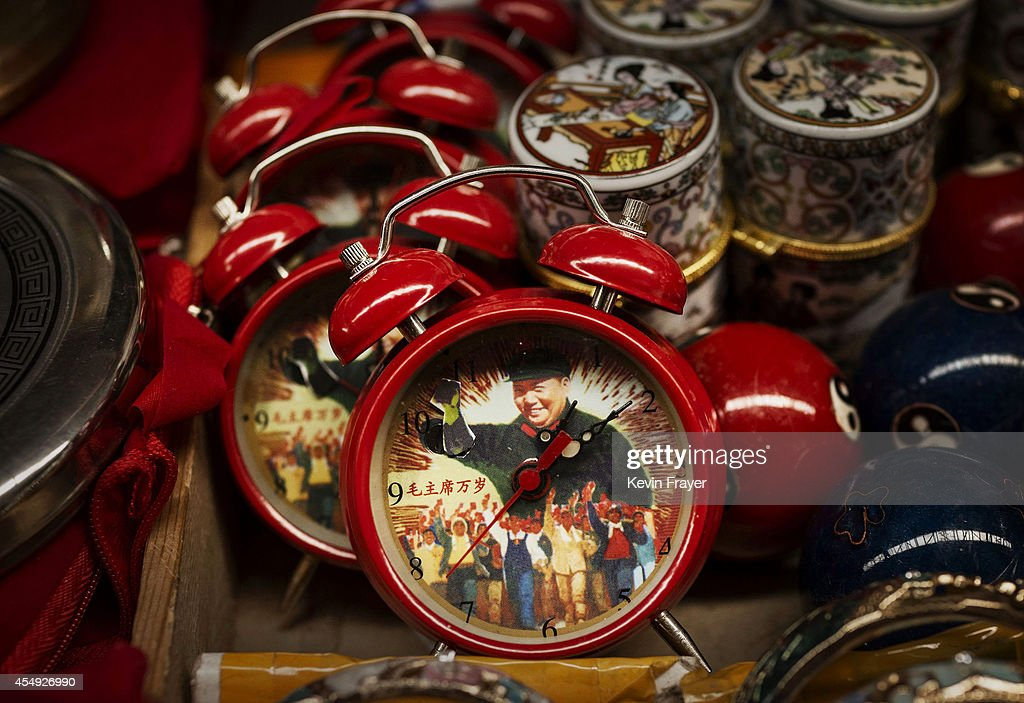 Alarm clocks showing the late Chinese leader Mao Zedong are seen for sale at a vendor's stand at a market on September 7, 2014 in Beijing, China. Chairman Mao, a Communist revolutionary and founding father of the People's Republic of China, led the country until his death September 9, 1976. Mao's ideology, though at times controversial, still wields influence over the leadership of modern China.