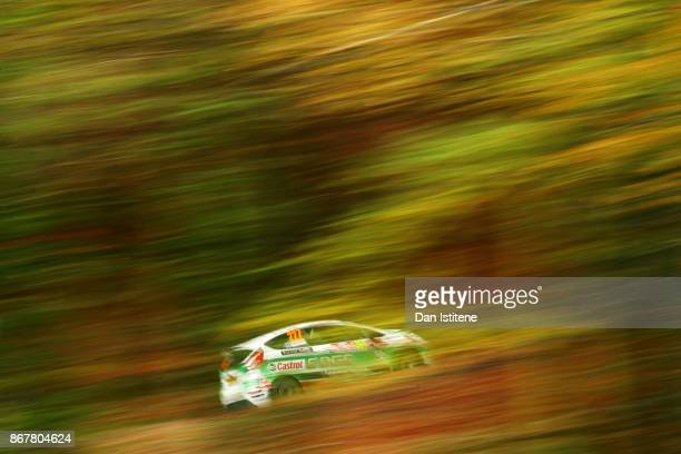 Alasdair Currie of Great Britain drives with codriver Steven Brown of great Britain during day three of the FIA World Rally Championship Great...