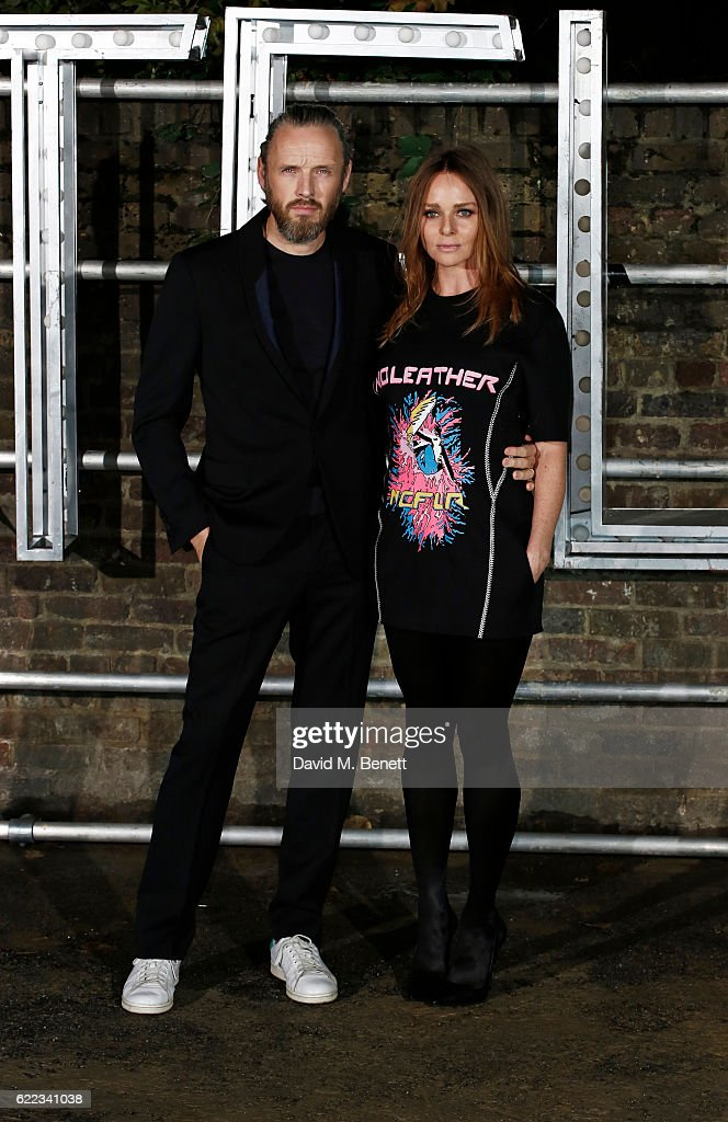 Alasdhair Willis (L) and Stella McCartney attend the Stella McCartney Menswear launch and Women's Spring 2017 collection presentation at Abbey Road Studios on November 10, 2016 in London, England.