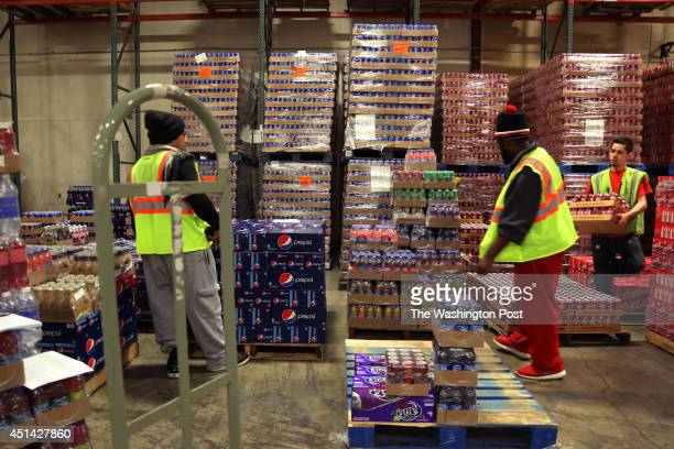 Alaska Commercial Company workers sort soft drinks at the company's shipping facilities in Anchorage AK on May 12 2014 Ten to 15 percent of Bypass...