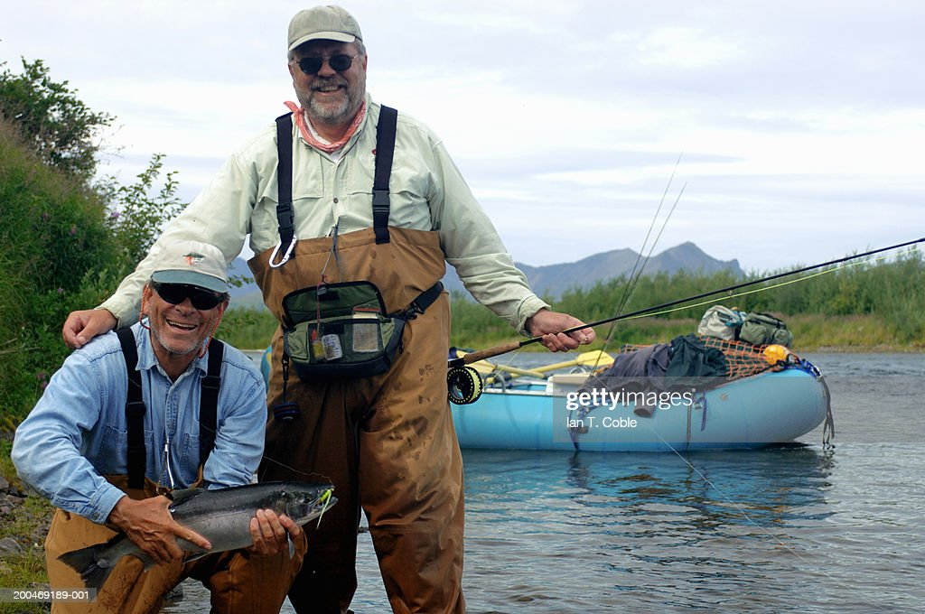 USA, Alaska, Goodnews River, two mature fisherman smiling, portrait : Stock Photo