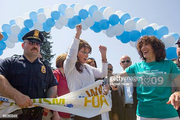 Alaska Governor and former Republican vice presidential candidate Sarah Palin helps cut a ribbon at an autism awareness fundraiser sponsored by...
