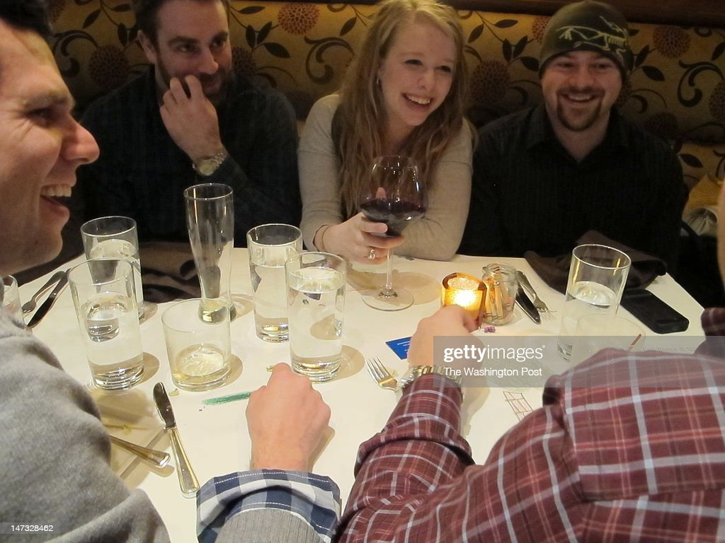 Alaska has the highest man to woman ratio of any of the 50 states. Courtney Enlow, 23, a oil company employee, CENTER enjoys the attentions of the many males at the Whale's Tale Bistro and Wine Bar in Anchorage, Alaska on March 2, 2012.