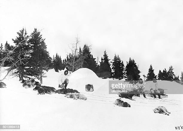 Inuit people next to their igloo probably in the 1910s