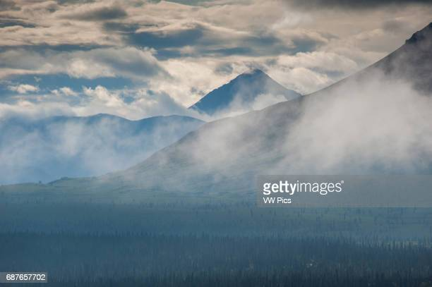 Alaskan mountain range obscured by afternoon haze