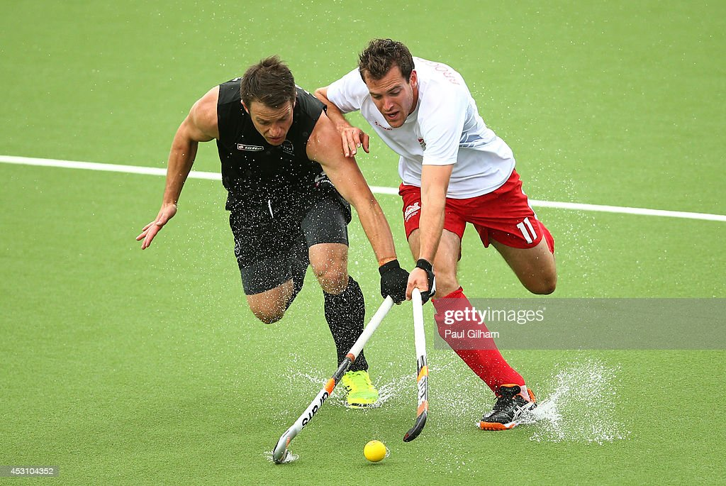 Alastair Brogdon of England and Shea McAleese of New Zealand battle for the ball in the bronze medal match between New Zealand and England at Glasgow National Hockey Centre during day eleven of the Glasgow 2014 Commonwealth Games on August 3, 2014 in Glasgow, United Kingdom.