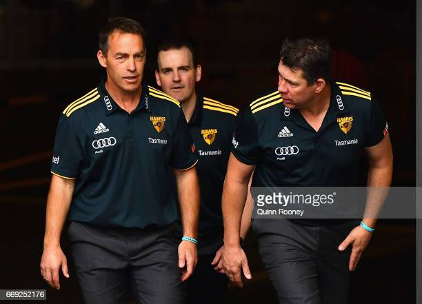 Alastair Clarkson and Brett Ratten walk out onto the field during the round four AFL match between the Hawthorn Hawks and the Geelong Cats at...