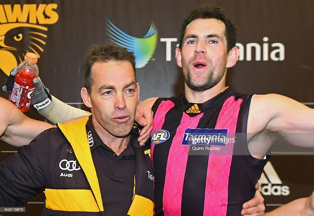 Alastair Clarkson and Luke Hodge of the Hawks sing the song in the rooms after winning the round 14 AFL match between the Hawthorn Hawks and the Gold Coast Suns at Aurora Stadium on June 26, 2016 in Launceston, Australia.