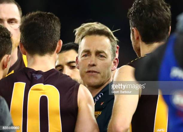 Alastair Clarkson coach of the Hawks speaks to his team during a quarter time break during the round 22 AFL match between the Carlton Blues and the...