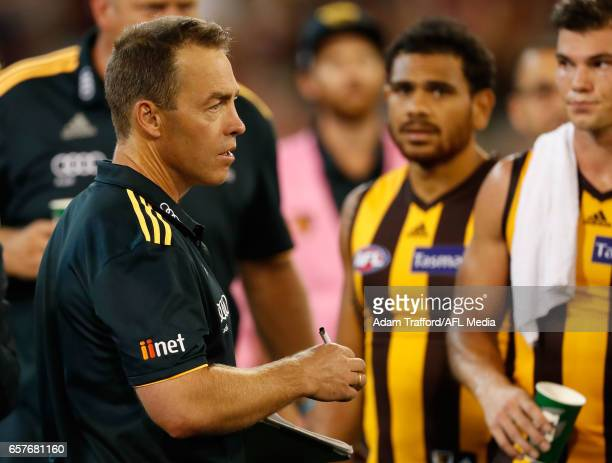 Alastair Clarkson Senior Coach of the Hawks addresses his players during the 2017 AFL round 01 match between the Essendon Bombers and the Hawthorn...