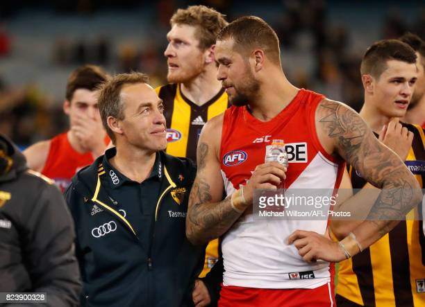 Alastair Clarkson Senior Coach of the Hawks and Lance Franklin of the Swans chat during the 2017 AFL round 19 match between the Hawthorn Hawks and...