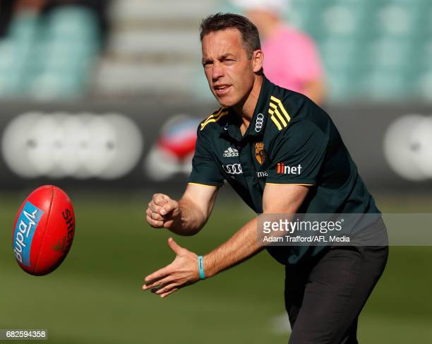 Alastair Clarkson Senior Coach of the Hawks helps players warmup during the 2017 AFL round 08 match between the Hawthorn Hawks and the Brisbane Lions...