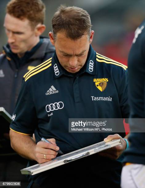 Alastair Clarkson Senior Coach of the Hawks writes during the 2017 AFL round 07 match between the Melbourne Demons and the Hawthorn Hawks at the...