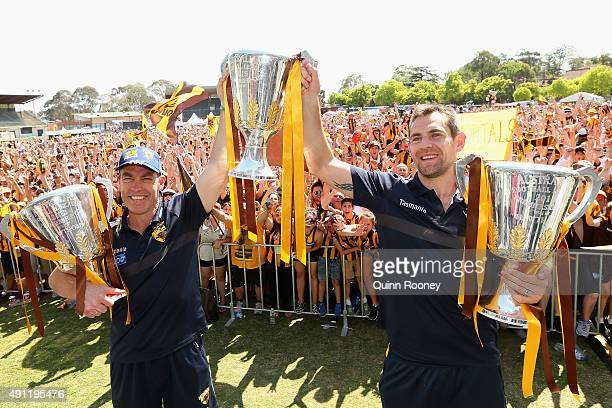 Alastair Clarkson the coach and Luke Hodge the captianHawks n the coach and Luke Hodge the captian of the Hawks pose with the 2013 2014 and 2015...