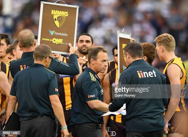 Alastair Clarkson the coach of the Hawks walks away after talking to his players during the round four AFL match between the Hawthorn Hawks and the...