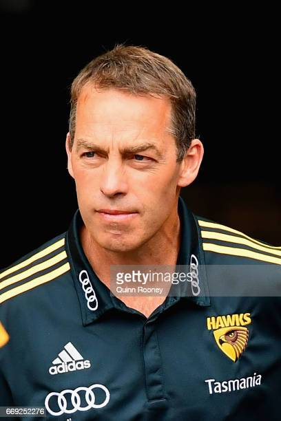 Alastair Clarkson the coach of the Hawks walks out onto the field during the round four AFL match between the Hawthorn Hawks and the Geelong Cats at...