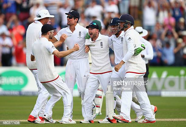 Alastair Cook and Adam Lyth of England and team mates celebrate victory during day four of the 1st Investec Ashes Test match between England and...