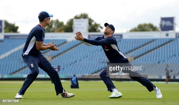 Alastair Cook and Dawid Malan of England take part in a fielding drill during a nets session at Headingley on August 23 2017 in Leeds England