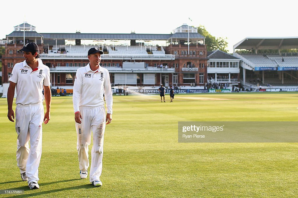 <a gi-track='captionPersonalityLinkClicked' href=/galleries/search?phrase=Alastair+Cook+-+Cricket+Player&family=editorial&specificpeople=571475 ng-click='$event.stopPropagation()'>Alastair Cook</a> and <a gi-track='captionPersonalityLinkClicked' href=/galleries/search?phrase=Joe+Root&family=editorial&specificpeople=6688996 ng-click='$event.stopPropagation()'>Joe Root</a> of England walk across the ground after day four of the 2nd Investec Ashes Test match between England and Australia at Lord's Cricket Ground on July 21, 2013 in London, England.