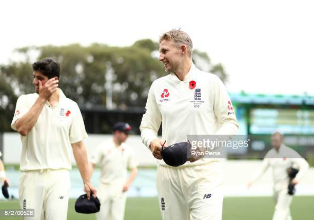 Alastair Cook and Joe Root of England walk from the ground during day four of the four day tour match between the Cricket Australia XI and England at...