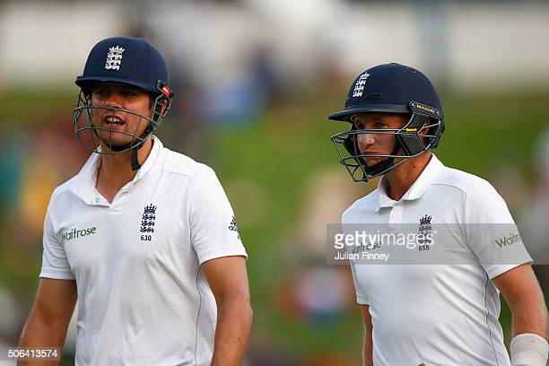 Alastair Cook and Joe Root of England walk off unbeaten at close of play during day two of the 4th Test at Supersport Park on January 23 2016 in...