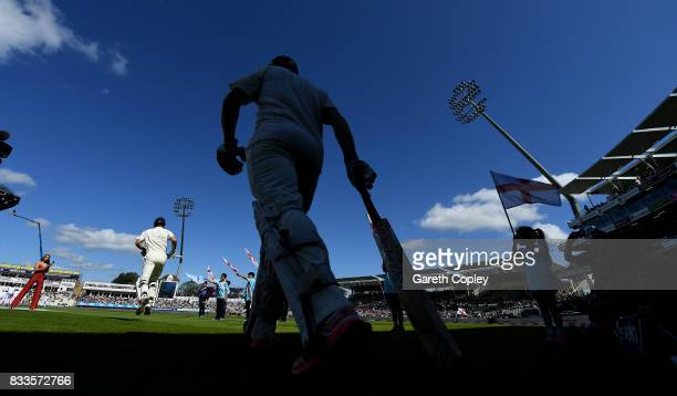 Alastair Cook and Mark Stoneman of England walk out to bat ahead of the 1st Investec Test match between England and West Indies at Edgbaston on...