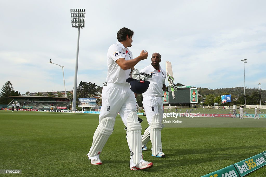 <a gi-track='captionPersonalityLinkClicked' href=/galleries/search?phrase=Alastair+Cook+-+Cricket+Player&family=editorial&specificpeople=571475 ng-click='$event.stopPropagation()'>Alastair Cook</a> and <a gi-track='captionPersonalityLinkClicked' href=/galleries/search?phrase=Michael+Carberry&family=editorial&specificpeople=600686 ng-click='$event.stopPropagation()'>Michael Carberry</a> of England leave the field at the end of play after both carrying their bats in an opening partnership of 318 during day one of the tour match between Australia A and England at Blundstone Arena on November 6, 2013 in Hobart, Australia.