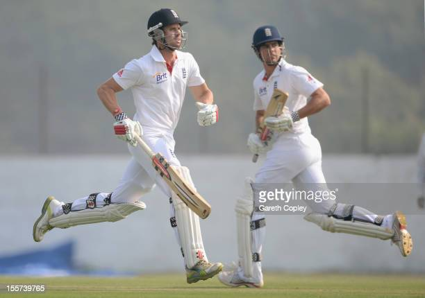 Alastair Cook and Nick Compton of England score runs during the tour match between England and Haryana at Sardar Patel Stadium ground B on November 8...