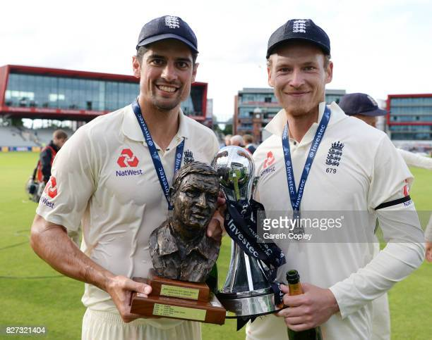 Alastair Cook and Tom Westley of England celebrate with the series trophy after winning the Investec Test series between England and South Africa at...
