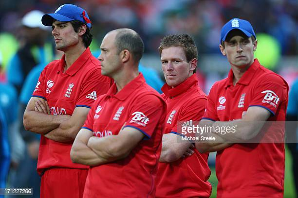 Alastair Cook captain of England looks on dejectedly during the trophy presentation alongside Jonathan Trott Eoin Morgan and Chris Woakes after their...